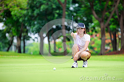 Golf player with putter