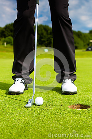 Free Golf Player Putting Ball In Hole Royalty Free Stock Photos - 30996338