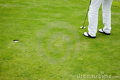 Golf player on putting green