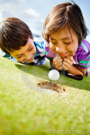 Golf players staring at the ball
