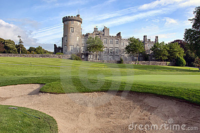 Golf sand bunker by golf green and castle