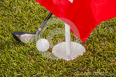 Golf theme on green grass and sky background