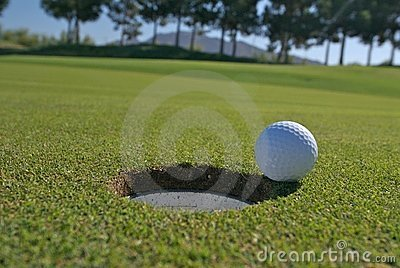 Golf unsunk putt on the lip