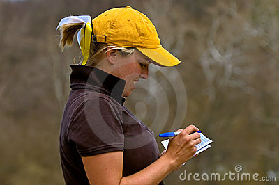 Golfer adding scorecard