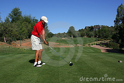 Golfer addressing ball