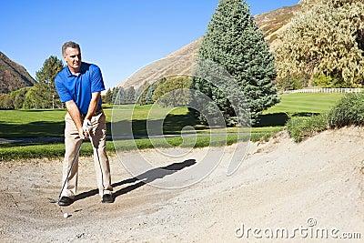 Golfer in the Bunker