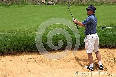 Golfer in the bunker.
