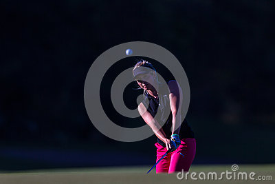 Girl Pro Golf Chip Ball Flight  Editorial Stock Image