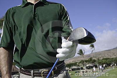 Golfer with driver club on the driving range