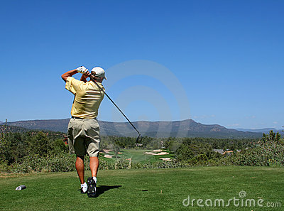Golfer driving golf ball