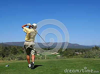Golfer driving golf ball