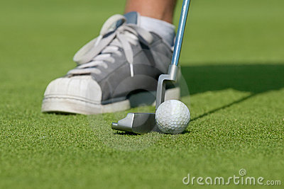 Golfer with driving-putter
