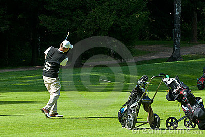 Golfer finishes his swing Editorial Photo