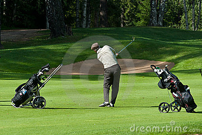Golfer finishes his swing Editorial Image