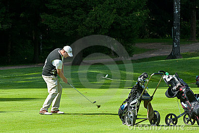Golfer finishes his swing Editorial Photography