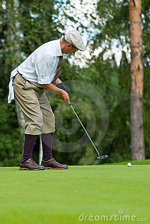 Golfer finishes his swing Editorial Stock Image
