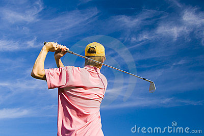 Golfer finishing his swing