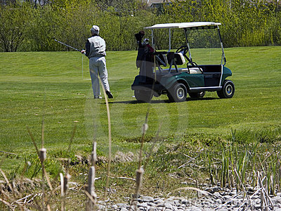 Golfer on Golf Course with Golf Cart