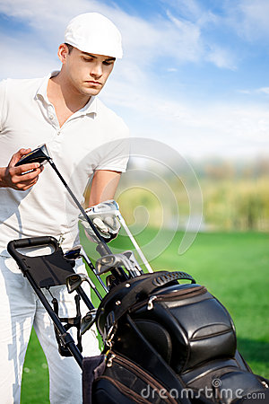 Golfer with golf equipment