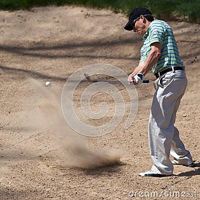 Golfer Hits His Golf Ball