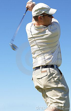 Golfer hitting the ball
