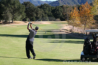 Golfer hitting down fairway