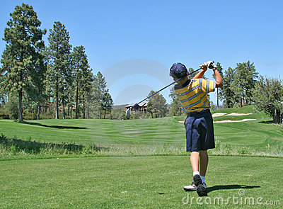 Golfer hitting a nice tee shot