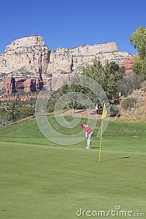 Golfer Hitting a Putt
