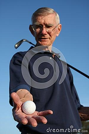 Golfer Holding Ball