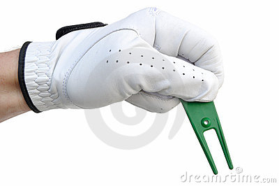 Golfer Holding a Ball Mark Repair Tool