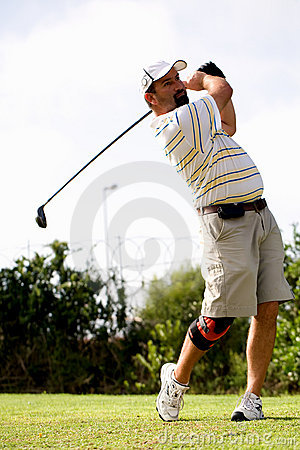 Golfer with knee brace.