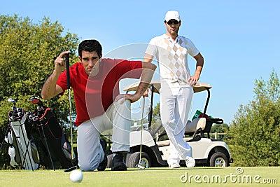 Golfer kneeling