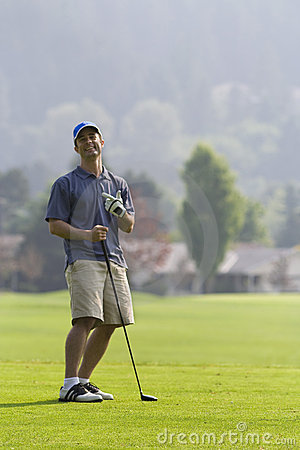 Golfer Laughing on Golf Course - Vertical
