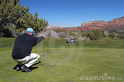 Golfer Lining His Putt