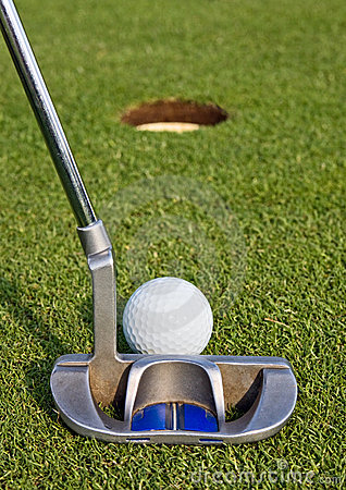 Golfer lining up a short putt