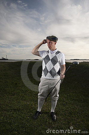 Golfer looking for his ball.