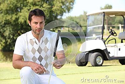 Golfer looking at his ball