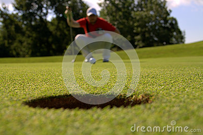 Golfer looking at hole