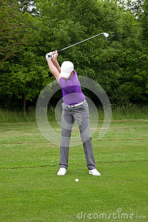 Golfer mid iron backswing