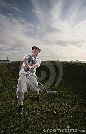 Golfer missing the ball.