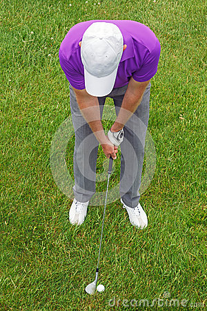 Golfer overhead shot from the rough.