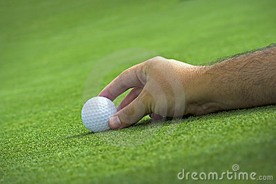 Golfer placing the ball