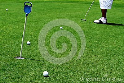 Golfer putting a golf ball
