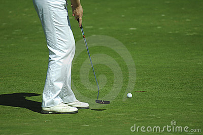 Golfer Putting A Golf Ball Stock Photography - Image: 7097502