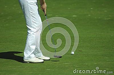 Golfer putting a golf ball