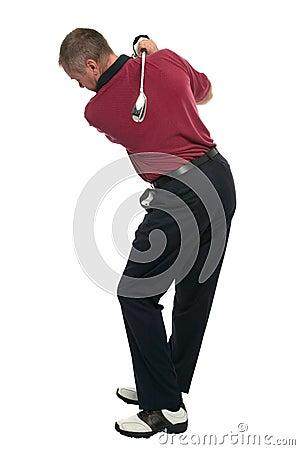 Golfer red shirt back swing