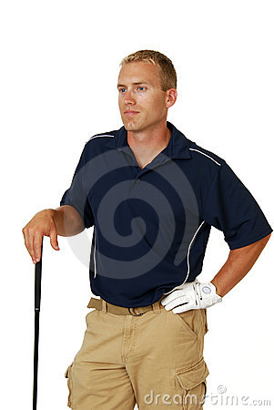 Golfer resting on his club