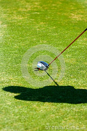Golfer s shadow while preparing to put