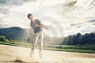 Golfer in sand trap.
