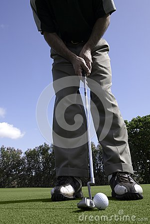 Golfer sets up for a putt
